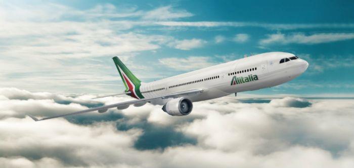 Alitalia dimezza le perdite